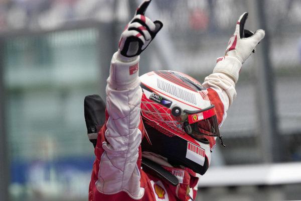 Kimi Raikkonen celebrates victory in parc fermé.