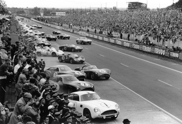 Le Mans, France. 10-11 June 1961.The cars and drivers make the traditional LeMans start behind Jean Kerguen/Jacques Dewez (#1 Aston Martin DB4GT Zagato). Roy Salvadori/Tony Maggs (#4 Aston Martin DBR1), Ludovico Scarfiotti/Nino Vaccarella (#9 Maserati Tipo 63), eventual winner Olivier Gendebien/Phil Hill (#10 Ferrari 250TR Testa Rossa) and Lucien Bianchi/Georges Berger (#15 Ferrari 250GT SWB) are among the first away.World Copyright: LAT PhotographicRef: Autosport b&w print