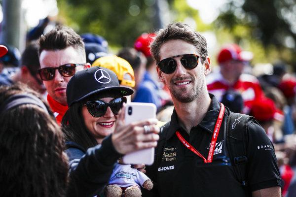 Romain Grosjean, Haas F1 Team poses for a selfie with a fan.