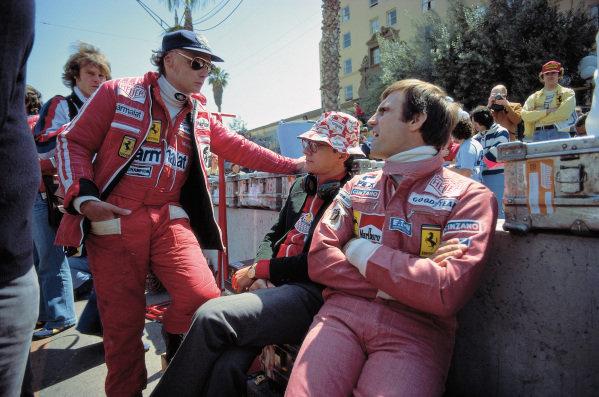 Niki Lauda, Daniele Audetto, and Carlos Reutemann.