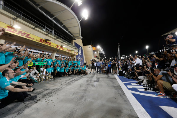 Bahrain International Circuit, Sakhir, Bahrain. Sunday 19 April 2015. Lewis Hamilton, Mercedes AMG, 1st Position, Nico Rosberg, Mercedes AMG, 3rd Position, and the Mercedes team celebrate victory. World Copyright: Alastair Staley/LAT Photographic. ref: Digital Image _79P9191