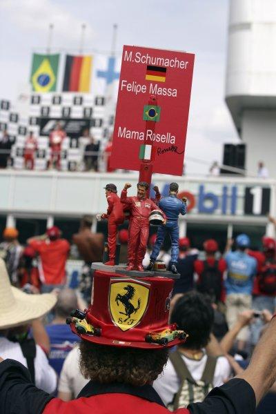2006 German Grand Prix - Sunday Race Hockenheim, Germany. 27th - 30th July. Ferrari fans get a good view of the podium. World Copyright: Charles Coates/LAT Photographic ref: Digital Image ZK5Y2440