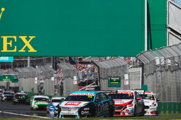 Michael Caruso, Nissan Motorsport Nissan, leads Garth Tander, Garry Rogers Motorsport Holden, and Will Davison, 23Red Racing Ford.