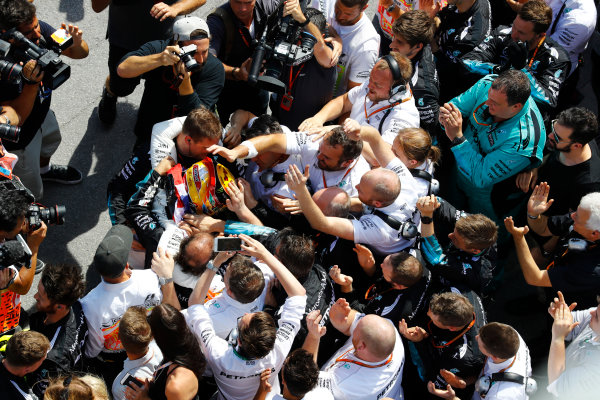Circuit Gilles Villeneuve, Montreal, Canada. Sunday 11 June 2017. Lewis Hamilton, Mercedes F1 W08 EQ Power+, celebrates victory with his team. World Copyright: Steven Tee/LAT Images ref: Digital Image _O3I0049