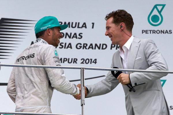Sepang International Circuit, Sepang, Kuala Lumpur, Malaysia. Sunday 30 March 2014. Actor Benedict Cumberbatch congratulates Lewis Hamilton, Mercedes AMG, 1st Position, on the podium. World Copyright: Steve Etherington/LAT Photographic. ref: Digital Image SNE10870 copy