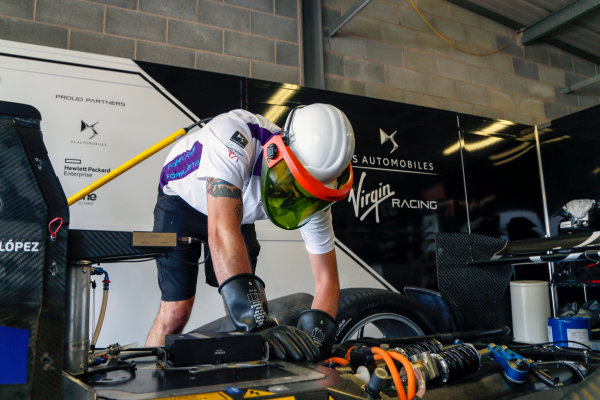 FIA Formula E Season 3 Testing - Day Two. Donington Park Racecourse, Derby, United Kingdom. A DS Virgin Racing team member at work on the Spark-Citroen of Jose Maria Lopez. Wednesday 24 August 2016. Photo: Adam Warner / LAT / FE. ref: Digital Image _14P2847