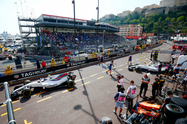 Monte Carlo, Monaco. Thursday 25 May 2017. Lance Stroll, Williams FW40 Mercedes, leads Felipe Massa, Williams FW40 Mercedes, out of the pits. World Copyright: Andy Hone/LAT Images ref: Digital Image _ONY7352