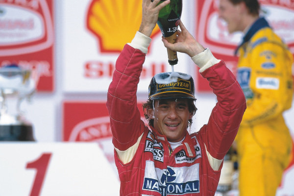 Interlagos, Sao Paulo, Brazil.26-28 March 1993.Ayrton Senna (McLaren Ford) celebrates 1st position on the podium.Ref-93 BRA 06.World Copyright - LAT PhotographicPlease Note: This image is available as a 30mb+ CMYK Tiff scan upon request.