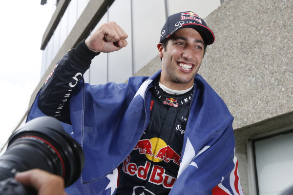 Circuit Gilles Villeneuve, Montreal, Canada. Sunday 8 June 2014. Daniel Ricciardo, Red Bull Racing, 1st Position, celebrates with his team. World Copyright: Alastair Staley/LAT Photographic. ref: Digital Image _79P1335