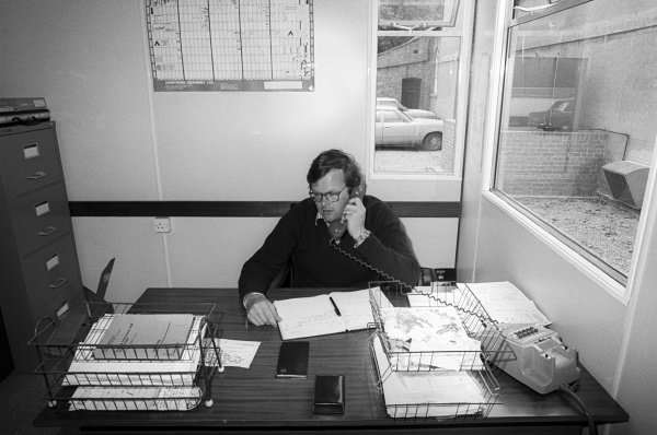 Anthony 'Bubbles' Horsley (GBR) Hesketh Team Manager behind the desk at the team's headquarters.