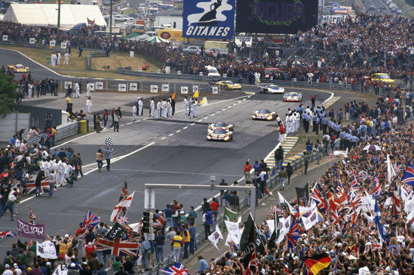 Le Mans, France. 11th - 12th June 1988. Jan Lammers/Johnny Dumfries/Andy Wallace (Jaguar XJR-9 LM), 1st position, leads Derek Daly/Kevin Cogan/Larry Perkins, (Jaguar XJR-9 LM), 4th position and Danny Sullivan/Davy Jones/Price Cobb (Jaguar XJR-9 LM), 16th position, across the line finishing line for the chequered falg and finish of the race, action. World Copyright: LAT Photographic ref: 88LM02