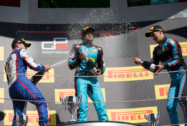 2017 GP3 Series Round 1.  Circuit de Catalunya, Barcelona, Spain. Sunday 14 May 2017. Winner of Race Two Arjun Maini (IND, Jenzer Motorsport) , second placed Dorian Boccolacci (FRA, Trident) and third placed Alessio Lorandi (ITA, Jenzer Motorsport) on the podium Photo: Jed Leicester/GP3 Series Media Service. ref: Digital Image JL1_0168