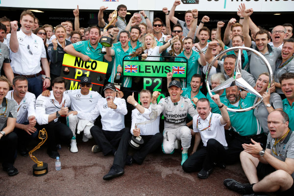 Monte Carlo, Monaco. Sunday 25 May 2014. Nico Rosberg, Mercedes AMG, 1st Position, Dr Dieter Zetsche, CEO, Mercedes Benz, Toto Wolff, Executive Director (Business), Mercedes AMG, Lewis Hamilton, Mercedes AMG, 2nd Position, and the Mercedes AMG team celebrate another victory. World Copyright: Charles Coates/LAT Photographic. ref: Digital Image _N7T0182
