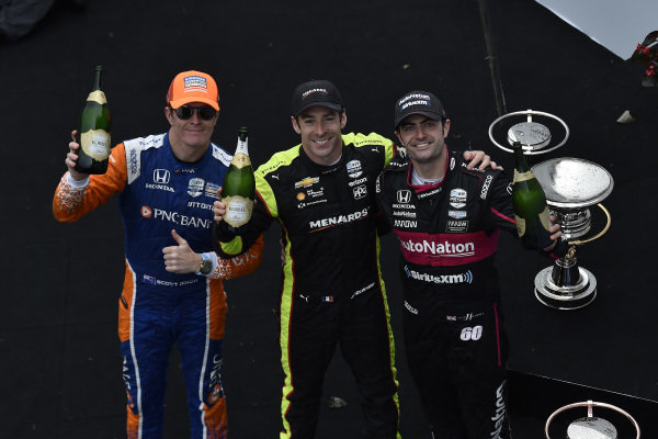 Simon Pagenaud, Team Penske Chevrolet, Scott Dixon, Chip Ganassi Racing Honda, Jack Harvey, Meyer Shank Racing celebrate the win in victory lane on the podium with champagne