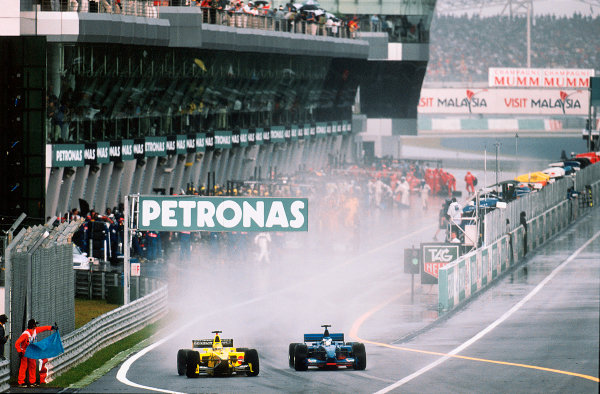 2001 Malaysian Grand Prix.Sepang, Kuala Lumpur, Malaysia. 16-18 March 2001.Heinz-Harald Frentzen (Jordan EJ11 Honda) and Jean Alesi (Prost AP04 Acer) exit the pits.World Copyright - Charles Coates/LAT Photographic ref:35mm Image A07