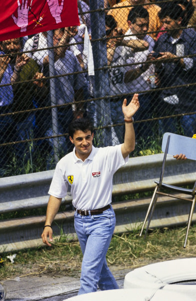 Jean Alesi waves to the crowd.