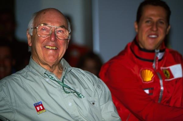 L-R: Murray Walker (GBR) bows out of commentating whilst Michael Schumacher(GER) looks on. USA Grand Prix, Indianapolis 30 September 2001 BEST IMAGE