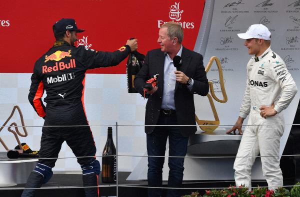 Daniel Ricciardo (AUS) Red Bull Racing, Martin Brundle (GBR) Sky TV and Valtteri Bottas (FIN) Mercedes AMG F1 celebrate on the podium at Formula One World Championship, Rd9, Austrian Grand Prix, Race, Spielberg, Austria, Sunday 9 July 2017.