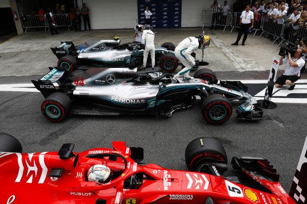 Lewis Hamilton, Mercedes AMG F1, celebrates pole position  in parc ferme between Valtteri Bottas, Mercedes AMG F1 W09, and Sebastian Vettel, Ferrari SF71H.
