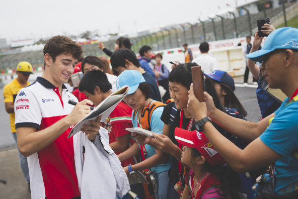 Charles Leclerc, Alfa Romeo Sauber F1 Team signs autographs for fans