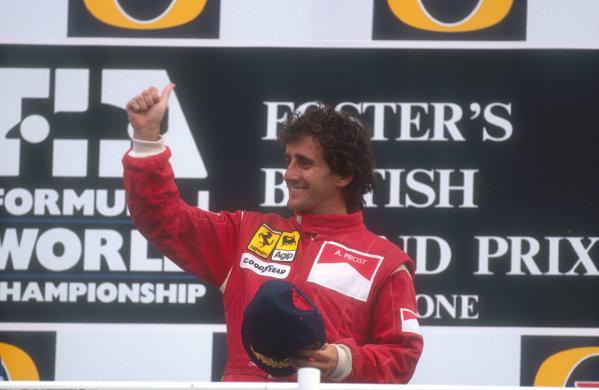 1990 British Grand Prix.Silverstone, England.13-15 July 1990.Alain Prost (Ferrari) celebrates his 1st position on the podium.Ref-90 GB 05.World Copyright - LAT Photographic