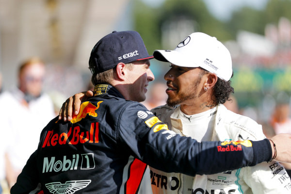 Max Verstappen, Red Bull Racing and Race winner Lewis Hamilton, Mercedes AMG F1 celebrate in Parc Ferme