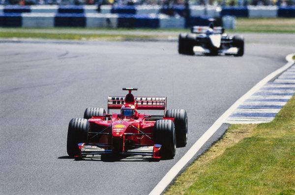 Eddie Irvine, Ferrari F399, leads Mika Häkkinen, McLaren MP4-14 Mercedes.