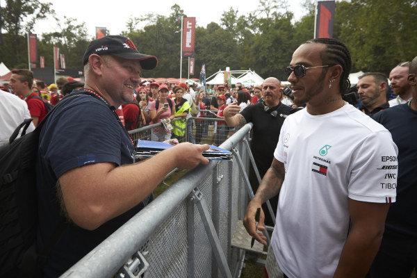 Lewis Hamilton, Mercedes AMG F1 signs an autograph for a fan