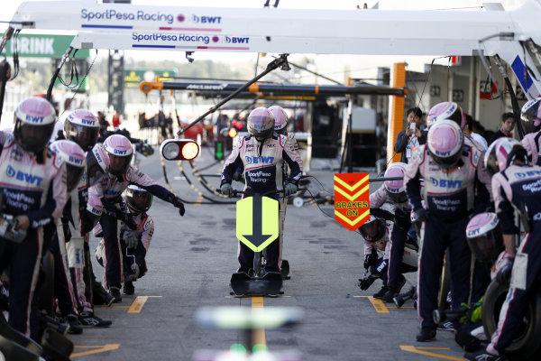 Racing Point mechanics practice a pit stop