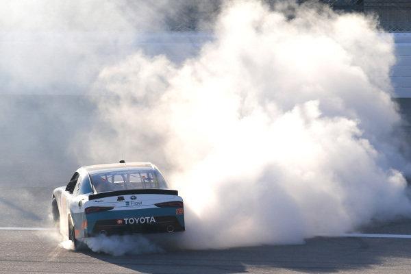 #19: Brandon Jones, Joe Gibbs Racing, Toyota Supra Flow celebrates his win with a burnout