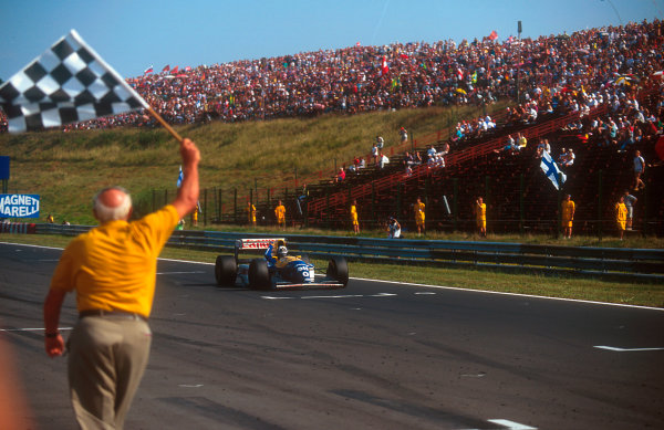1993 Hungarian Grand Prix.Hungaroring, Budapest, Hungary.13-15 August 1993.Damon Hill (Williams FW15C Renault) holds his fist aloft as he takes the chequered flag for his maiden Grand Prix win.Ref-93 HUN 02.World Copyright - LAT Photographic