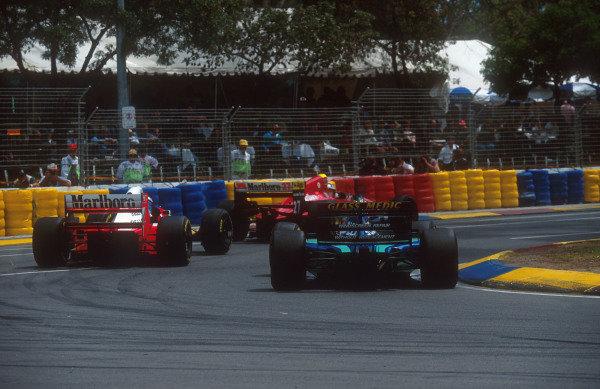 1994 Australian Grand Prix.Adelaide, Australia.11-13 November 1994.Jean Alesi (Ferrari 412T1B) closely followed by Mika Hakkinen (McLaren MP4/9 Peugeot) and Rubens Barrichello (Jordan 194 Hart).Ref-94 AUS 24.World Copyright - LAT Photographic
