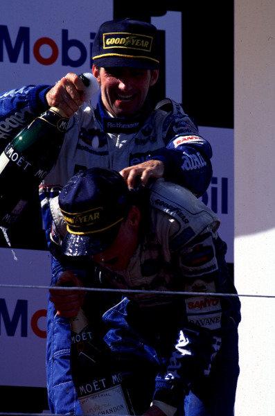 1995 Portuguese Grand Prix.Estoril, Portugal.22-24 September 1995.David Coulthard (Williams Renault) 1st position on the podium.World Copyright - LAT Photographic