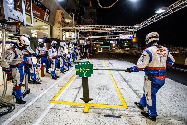 Toyota Racing team members wait for #7 Toyota Racing Toyota TS 040 - Hybrid