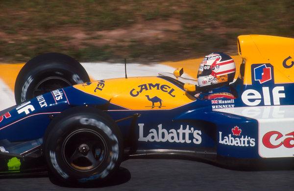 1992 Brazilian Grand Prix.Interlagos, Sao Paulo, Brazil.3-5 April 1992.Nigel Mansell (Williams FW14B Renault) 1st position.Ref-92 BRA 14.World Copyright - LAT Photographic