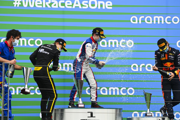 Oscar Piastri (AUS, PREMA RACING), Race winner David BECKMAN (DEU, TRIDENT MOTORSPORT) and Dennis Hauger (NOR, HITECH GRAND PRIX) celebrate on the podium with the champagne