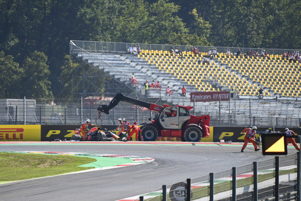 Marshals remove the car of Max Verstappen, Red Bull Racing RB16