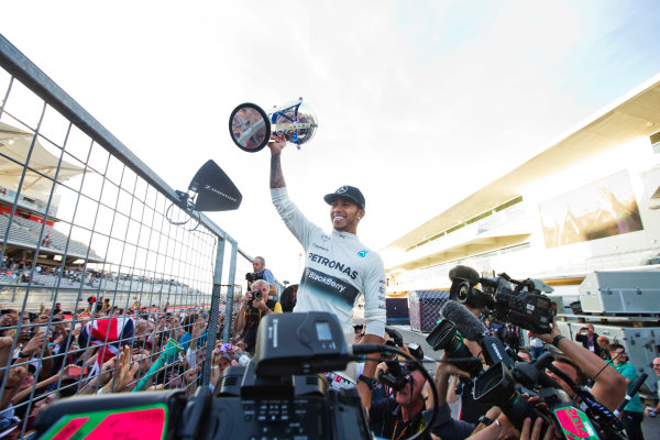 Circuit of the Americas, Austin, Texas, United States of America. Sunday 2 November 2014. Lewis Hamilton, Mercedes AMG, celebrates his win with the fans. World Copyright: Charles Coates/LAT Photographic. ref: Digital Image _J5R1567
