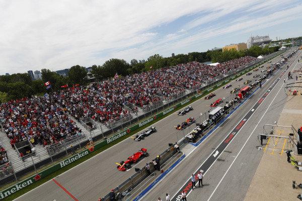 Sebastian Vettel, Ferrari SF71H, leads at the start from Valtteri Bottas, Mercedes AMG F1 W09, Max Verstappen, Red Bull Racing RB14 Tag Heuer, Lewis Hamilton, Mercedes AMG F1 W09, Kimi Raikkonen, Ferrari SF71H, Daniel Ricciardo, Red Bull Racing RB14 Tag Heuer and the rest of the pack.