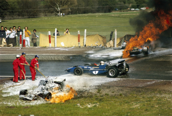 Jackie Stewart, March 701 Ford drives between the flaming wrecks of Jackie Oliver's BRM P153 and Jacky Ickx's Ferrari 312B.