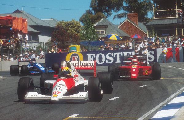 1990 Australian Grand Prix. Adelaide, Australia. 2-4 November 1990. Ayrton Senna (McLaren MP4/5B Honda) leads Nigel Mansell (Ferrari 641). Philippe Alliot (Ligier JS33B Ford) just behind, action.  World Copyright: LAT Photographic. Ref:  90 AUS 10.