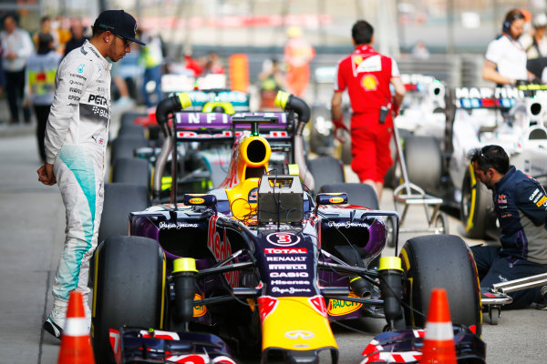 Shanghai International Circuit, Shanghai, China. Saturday 11 April 2015. Lewis Hamilton, Mercedes AMG, inspects the car of Daniel Ricciardo, Red Bull Racing RB11 Renault, in Parc Ferme. World Copyright: Andrew Hone/LAT Photographic. ref: Digital Image _ONZ1701