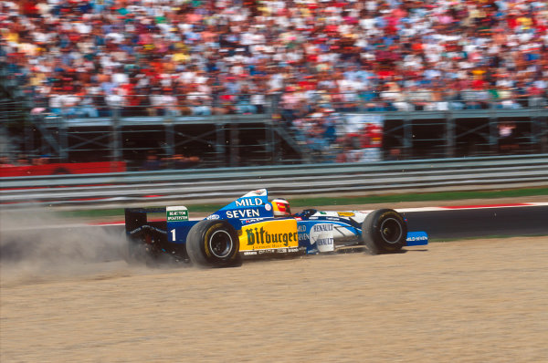 Monza, Italy.8-10 September 1995.Michael Schumacher (Benetton B195 Renault) takes to the gravel. He exited the race after being hit by Hill. Ref-95 ITA 12.World Copyright - LAT Photographic