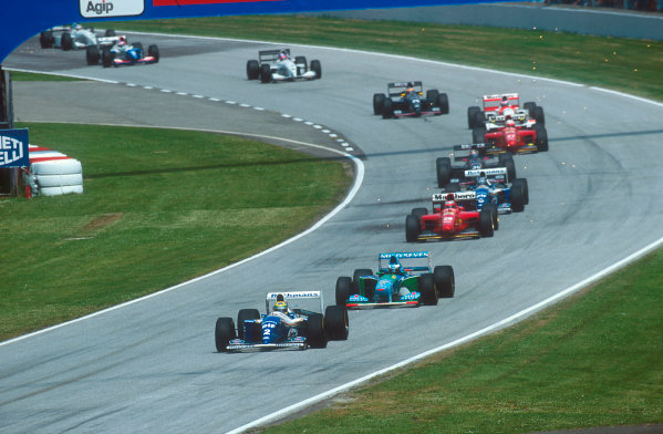 Imola, Italy.29/4-1/5 1994.Ayrton Senna (Williams FW16 Renault) leads Michael Schumacher (Benetton B194 Ford), Gerhard Berger (Ferrari 412T1), Damon Hill (Williams FW16 Renault), Heinz-Harald Frentzen (Sauber C13 Ford), Nicola Larini (Ferrari 412T1), Mika Hakkinen (McLaren MP4/9 Peugeot) and Karl Wendlinger (Sauber C13 Ford) at the start.Ref-94 SM 54.World Copyright - LAT Photographic