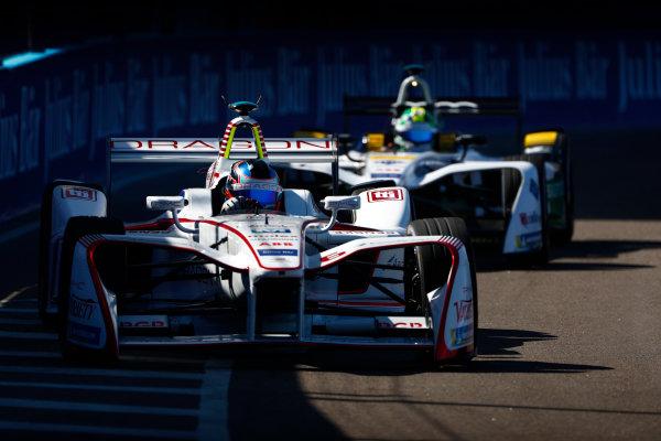 Jose Maria Lopez (ARG), Dragon, Penske EV-2, leads Lucas Di Grassi (BRA), Audi Sport ABT Schaeffler, Audi e-tron FE04.