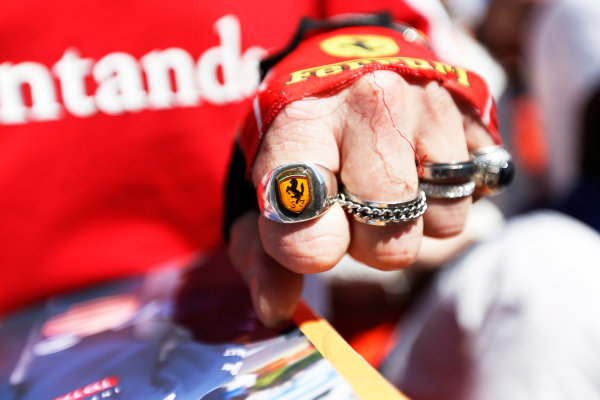 Monte Carlo, Monaco. Friday 22 May 2015. Prancing Horse Ferrari badge on a ring worn by a fan. World Copyright: Charles Coates/LAT Photographic. ref: Digital Image _J5R0813
