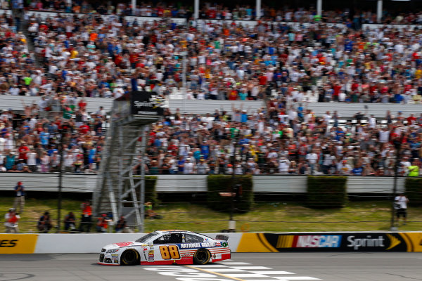 6-8 June, 2014, Long Pond, Pennsylvania USA Dale Earnhardt Jr takes the checkered flag to win the race ?2014, Lesley Ann Miller LAT Photo USA