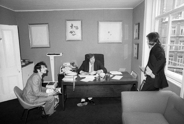 Lord Alexander Hesketh (GBR) Hesketh Team Owner (Centre) behind the desk at the headquarters of Hesketh Racing.