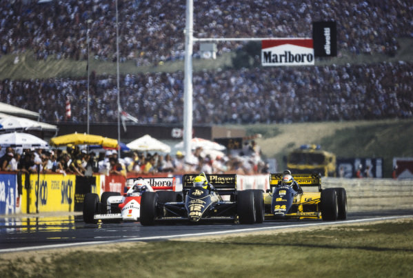 Ayrton Senna, Lotus 98T Renault leads Alessandro Nannini, Minardi M/85B Motori Moderni and Alain Prost, McLaren MP4-2C TAG.