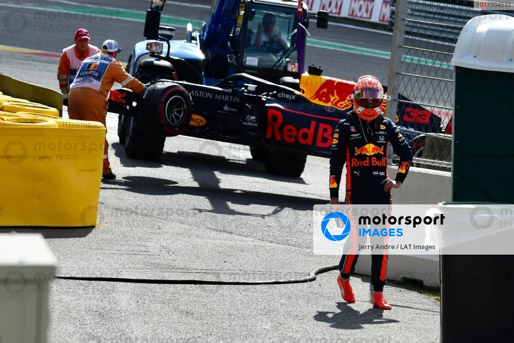 Max Verstappen, Red Bull Racing, stands by as Marshals remove his car from the circuit